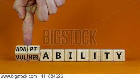 Vulnerability Or Adaptability Symbol. Businessman Turns Cubes And Changes Words 'vulnerability' To '