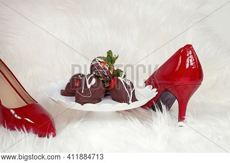 Chocolate Covered Strawberries On Pedestal Dish On White Fur With Red Pumps