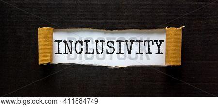 Belonging And Inclusivity Symbol. The Word 'inclusivity' Appearing Behind Torn Black Paper. Beautifu