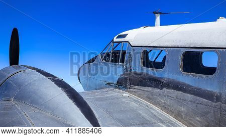Close Up Of An Historical Aircraft Against A Blue Sky