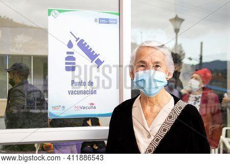 La Calera, Colombia - March 2021. Senior Woman Arriving To A Covid-19 Vaccination Post In Colombia.