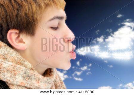 Teenager Blowing Magic Stars