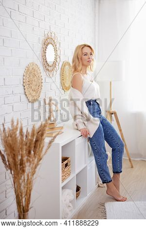 Home And Cosiness Concept - Full Length Portrait Of Young Slim Woman Posing In Modern Living Room