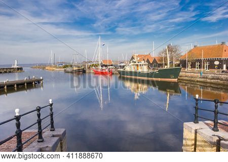 Jetties And Ships In The Historic Harbor Of Hindeloopen, Netherlands