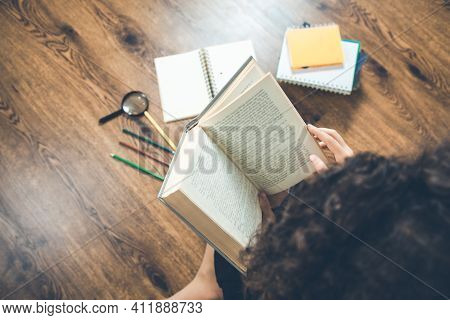 The Woman Hand Holding Books With Stationary