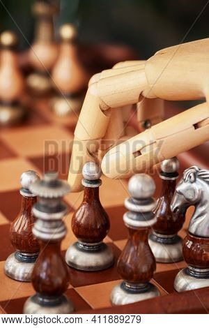 Cropped Shot Of Robot Hand Playing Chess, Moving Chess Figure On Chess Board, Selective Focus