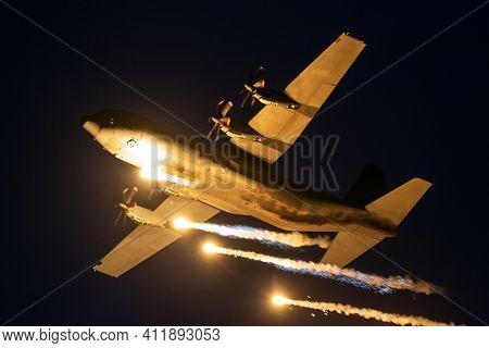 Sanicole, Belgium - Sep 13, 2019: Danish Air Force Lockheed C-130 Hercules Military Plane Firing Fla