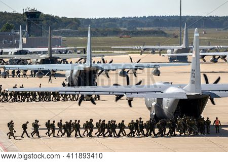 Eindhoven, Netherlands - Sep 20, 2019: Paratroopers Entering A Us Air Force C-130 Hercules Transport