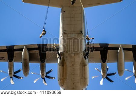 Ede, Netherlands - Sep 21, 2019: Group Of Military Parachutist Paratroopers Jumping Out Of A Transpo