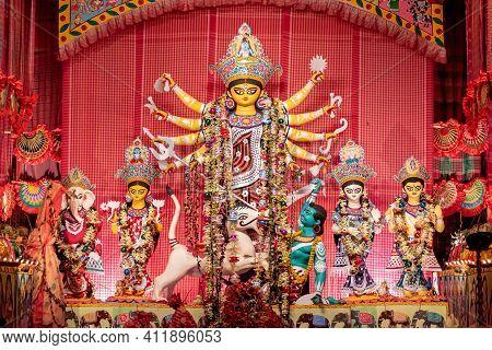 Goddess Durga Idol At Decorated Durga Puja Pandal, Shot At Colored Light, At Kolkata, West Bengal, I