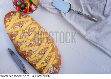 Vertical View Of A Coca De Sant Joan, A Typical Sweet Flat Cake From Catalonia, Spain, Eaten At Sain