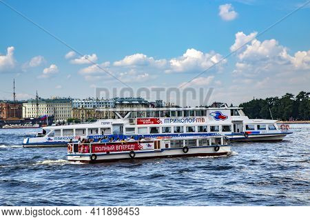 Russia, Saint Petersburg, April, 2016 - A View Of The Neva River With Excursion Pleasure Ships At Th