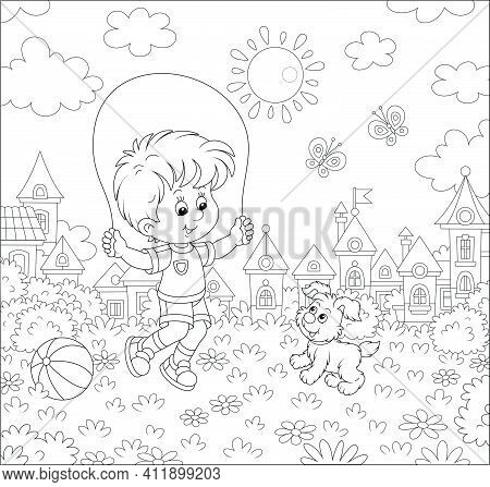 Happy Little Boy Jumping Rope With His Cute And Merry Pup In A Summer Park Of A Small Town, Black An