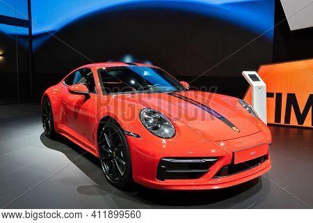 Brussels - Jan 9, 2020: Porsche 911 Carrera Sports Car Showcased At The Brussels Autosalon 2020 Moto