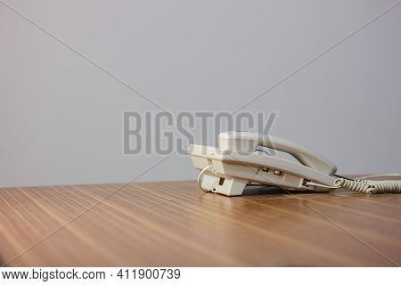 Telephone On Desk With White Background, Communication Dialing At Office Table Supplier