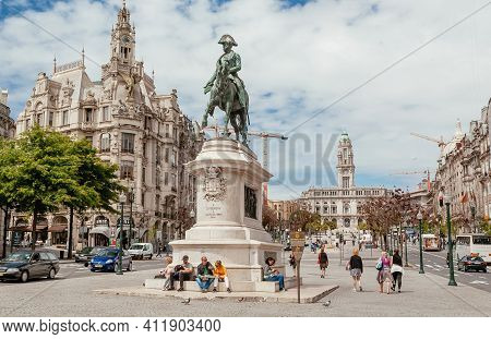Porto, Portugal: People Relaxing In Sunny City With Busy Streets And Historical Monuments On 20 May,