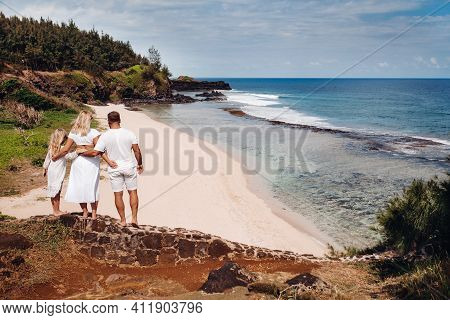 A Family In White With Three People Looks Into The Distance Of Gris Gris Beach On The Island Of Maur