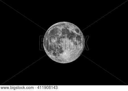 Super Moon On Black Background. Full Moon Background Isolated On Black