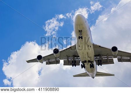 Front Bottom Image Large Commercial Passenger Aircraft Or Cargo Transportation Airplane Flying On Bl