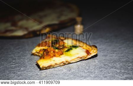 Bitten Slice Of Pizza On A Gray Background