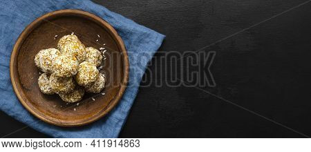 Banner Home Made Nutritious Energy Balls Consisting Of Nuts, Oatmeal, Honey, Dried Fruits On A Clay