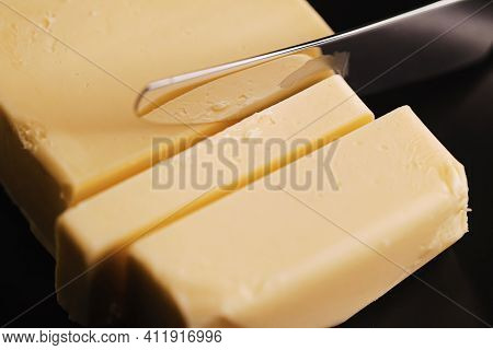 Sliced Organic Butter Block And Knife, Breakfast Food Closeup
