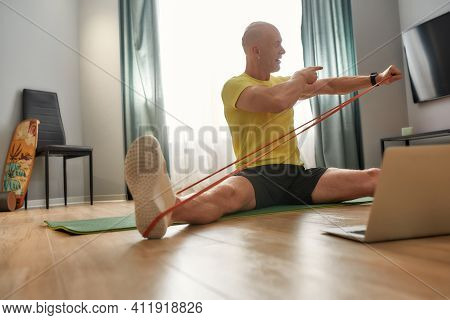 Trainer Showing How To Doing Exercising With An Elastic Band For Sports. Sports Trainer Conducting O
