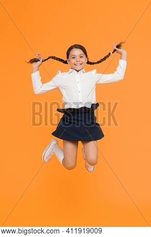 Happy Child Jumping In School Uniform. Having Fun. Time For Fun. School Break. Jumping And Feeling F