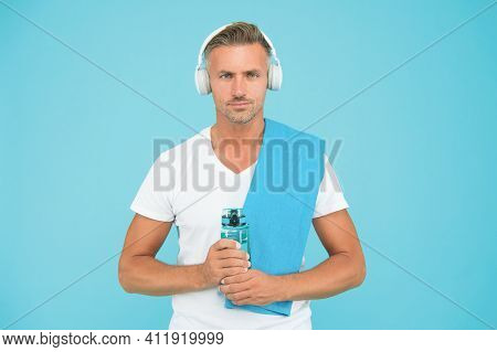 Sportsman Gym Instructor With Water Bottle And Headphones. Healthy Lifestyle. Gym Aesthetics. Mature