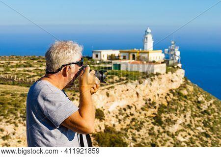Male Tourist With Camera Taking Travel Photo From Mesa Roldan Lighthouse, Cabo De Gata Nijar Natural