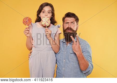 Surprise Victory. Surprised Family Yellow Background. Father And Daughter Celebrate Victory. Bearded