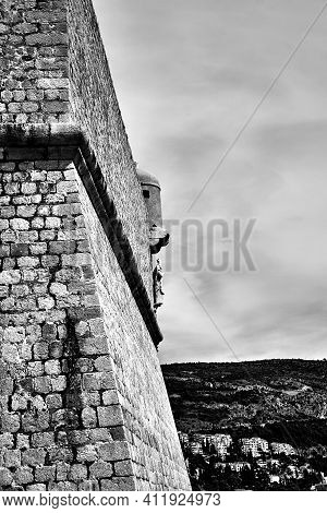 Detail Of The Stone, Medieval Defense Walls Of The City Of Dubrovnik In Croatia, Monochrome