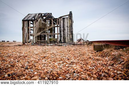 deserted coast of Dungeness with old fishing boats