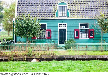 typical Dutch houses in Zaanse Schans is a museum village with dutch houses and wind mills, Zaandam, Netherlands