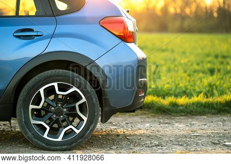 Close Up Of Blue Off Road Car Wheel On Gravel Road. Traveling By Auto, Adventure In Wildlife, Expedi