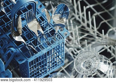Open Dishwasher Machine With Clean Dinnerware In The Kitchen, Closeup