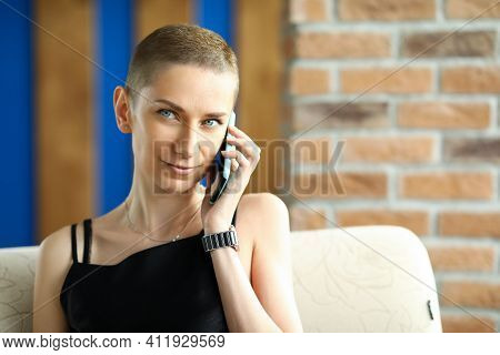 Portrait Of Smiling Woman Looking Away With Gladness And Calmness. Happy Female Person Talking On Ce