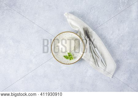 Top View Of Ball Mozzarella Cheese With Basil Leaves As Ingredients For Light Meals On Light Gray Co