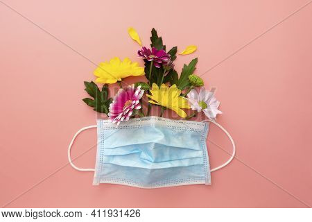 Medical Blue Face Protective Mask With Colorful Flowers. Concept Of Seasonal Allergies. Spring 2021