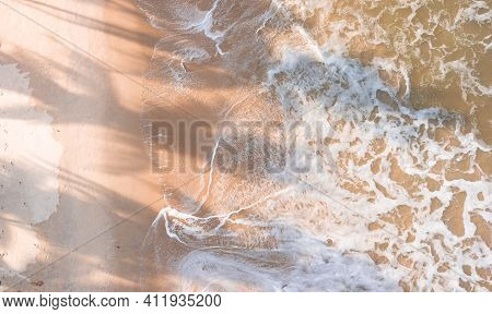 Drone Aerial View Beach Waves At Sunset.