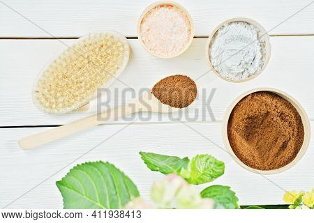 Homemade Exfoliating Scrub Ingredients. Ground Coffee, Himalayan Pink Salt, Clay Powder And Body Bru