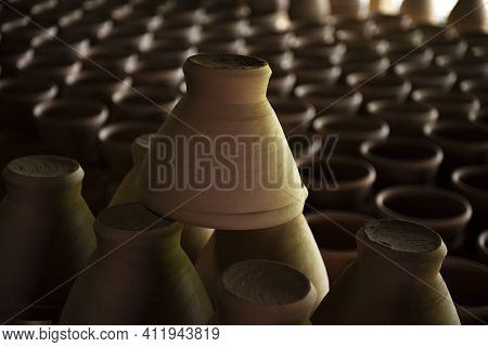 A Narrow Depth-of-field, Blurred Background And A Large Traditional Indigenous Pottery Jar Sits Side