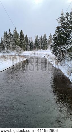 Winter Snow Forest River View. Winter Forest River Landscape. Snowy Winter Forest River Scene. Winte