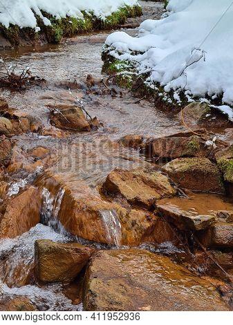 Orange Rocks In River Creek Water. Forest River Creek Rocks. Rocks In Creek Water. Forest Rocks In C