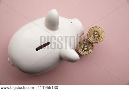 Bitcoin Cryptocurrency Coins With A White Piggy Bank Saving Money Box