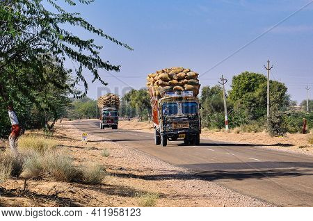 Jaisalmer, India - Jan 01, 2020: Two Old Trucks On The Road To Jaisalmer On The Edge Of The Thar Des