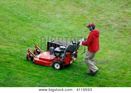 Man mowing the lawn with copy space poster
