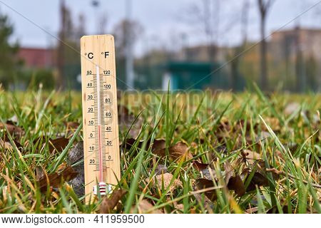 Close-up Photo Of Household Alcohol Thermometer In Grass Showing Temperature In Degrees Celsius. Out