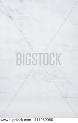 Light White Grey Marble Hexagon Tile Wall Unfocused With White Wood Board As Floor, Empty Interior O