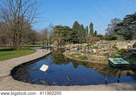 Lyon, France, March 10, 2021 : A Small Pool Of Water For Waterlilies. Parc De La Tete D'or Is One Of
